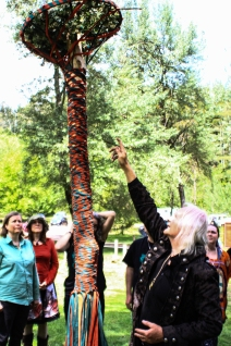 Reading the Maypole at the 2015 Gathering. Photo courtesy of Kylie Moroney.