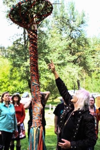 Reading the Maypole at the 2015 Gathering. Photo courtesy of Kylie Moroney.