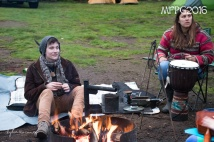Relaxing by the fire at the 2016 Gathering. Photo by Kylie Moroney.